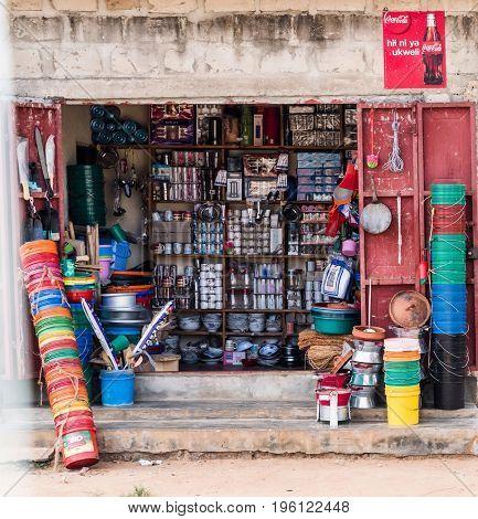 Zanzibar, Tanzania - July 15, 2016: Small shop selling baskets and plastic items in zanzibar, tanzania, open market, poor place