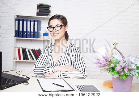 business girl in glasses works in the Office of the Secretary