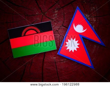 Malawi Flag With Nepali Flag On A Tree Stump Isolated