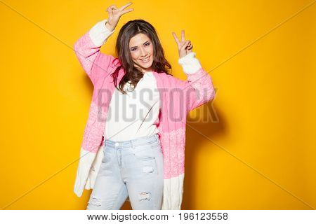 bright girl shows two fingers on the hands 1