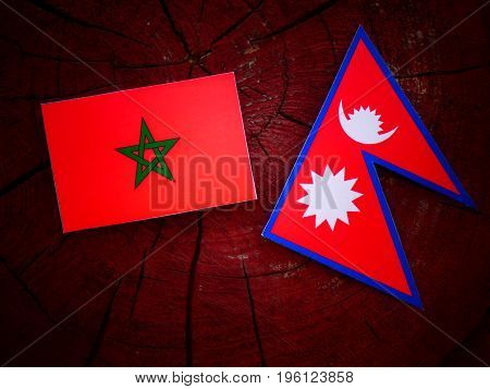 Moroccan Flag With Nepali Flag On A Tree Stump Isolated