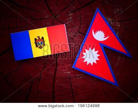Moldovan Flag With Nepali Flag On A Tree Stump Isolated