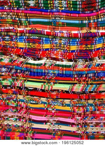 Columns of folded colorful blankets in bolivian street market, La Paz, Bolivia.