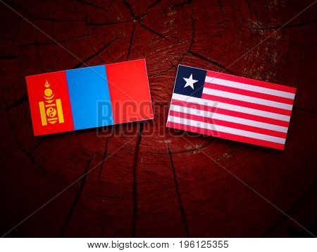 Mongolian Flag With Liberian Flag On A Tree Stump Isolated