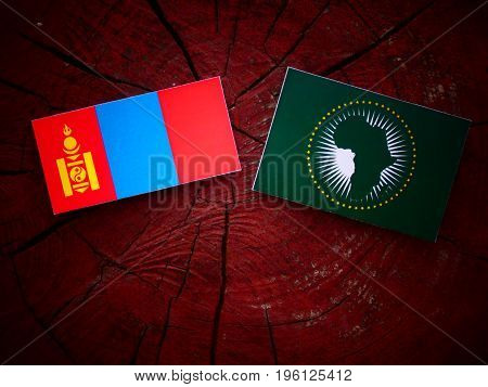 Mongolian Flag With African Union Flag On A Tree Stump Isolated