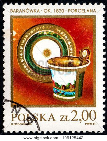 UKRAINE - CIRCA 2017: A postage stamp printed in Poland shows Porcelan Cup and Saucer 1820 from the series Polish Ceramics circa 1981