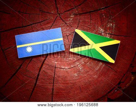 Nauru Flag With Jamaican Flag On A Tree Stump Isolated