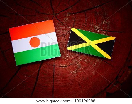 Niger Flag With Jamaican Flag On A Tree Stump Isolated