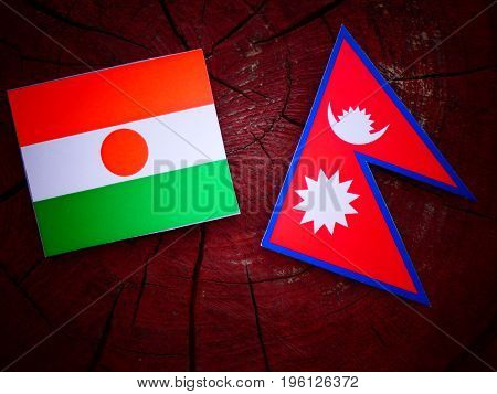 Niger Flag With Nepali Flag On A Tree Stump Isolated