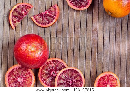wooden striped background from cut Sicilian oranges with space