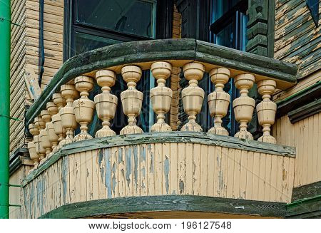Old cracked wooden railing with peeling paint