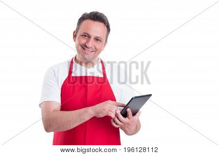 Supermarket Clerk Using Touch Screen Tablet At Work