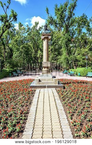 Central park with statue of Alexander Puskin, Chisinau, Moldova, sunny day blue sky trees and flowers
