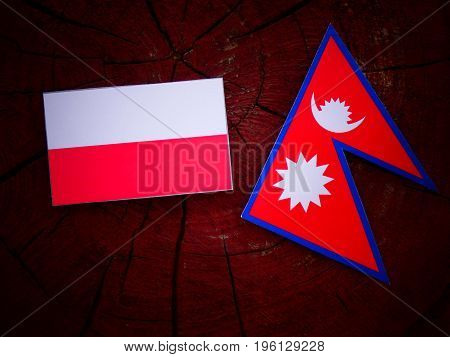 Polish Flag With Nepali Flag On A Tree Stump Isolated