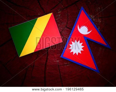 Republic Of The Congo Flag With Nepali Flag On A Tree Stump Isolated