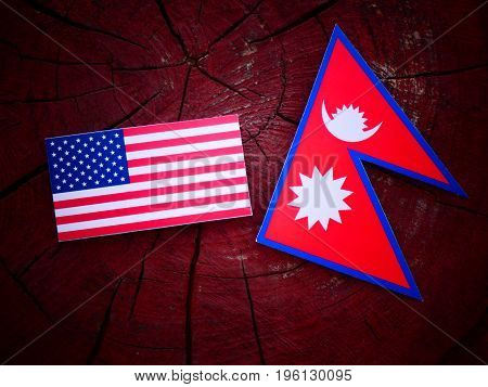 Usa Flag With Nepali Flag On A Tree Stump Isolated