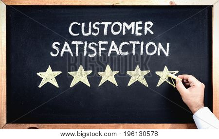 Customer Satisfaction Concept Man Filling In Rating Stars On Blackboard