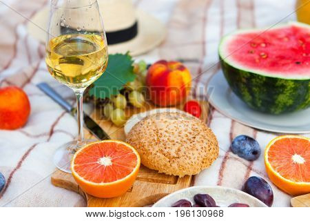 Summer Picnic Basket On The Green Grass. Food And Drink Concept. Friends Party