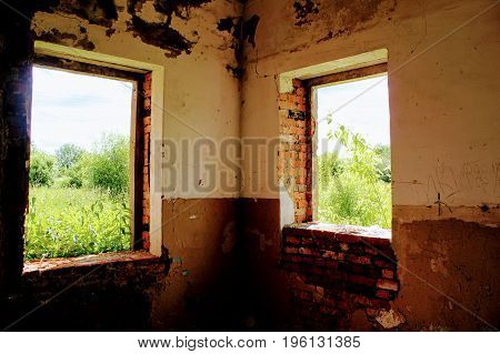 Inside an old abandoned building of warehouse for mineral fertilizers in June 2017, Arsenyevo, Russia.