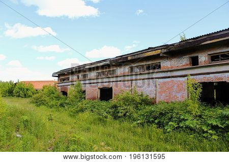 An old abandoned building of warehouse for mineral fertilizers in June 2017, Arsenyevo, Russia.