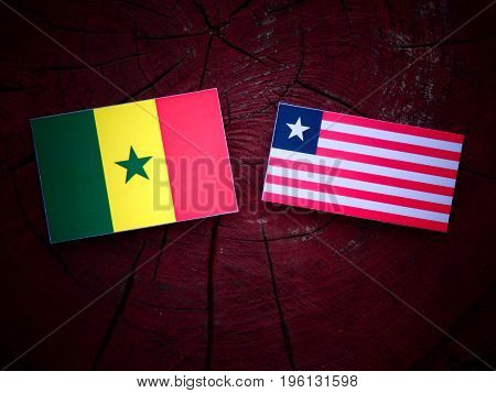 Senegal Flag With Liberian Flag On A Tree Stump Isolated
