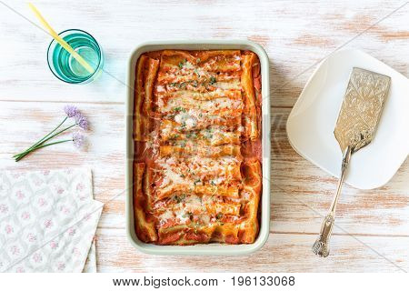 Top view of homemade cannelloni stuffed with spinach and ricotta
