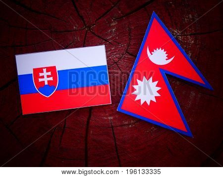 Slovakian Flag With Nepali Flag On A Tree Stump Isolated