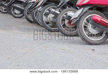 motorcyle wheel dirty parked in public park on the road with copy space add text