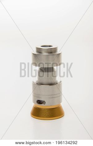 Dismantled parts of the electronic cigarette black and steel colors on a white background