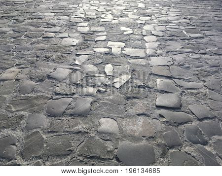 Beautiful background: Lviv pavement close up - stone paving stones