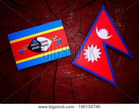Swaziland Flag With Nepali Flag On A Tree Stump Isolated