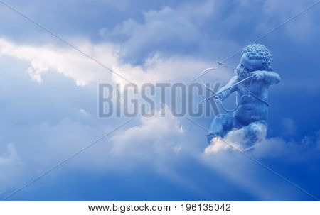 Cupid with arrow in sky concept of love