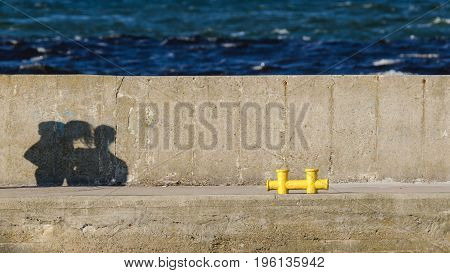 SHADOWS - Couple of people on a holiday on the seaside