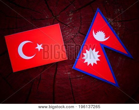Turkish Flag With Nepali Flag On A Tree Stump Isolated