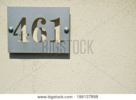 House numbers four hundreds and sixty one (461 four six one) on a gray background
