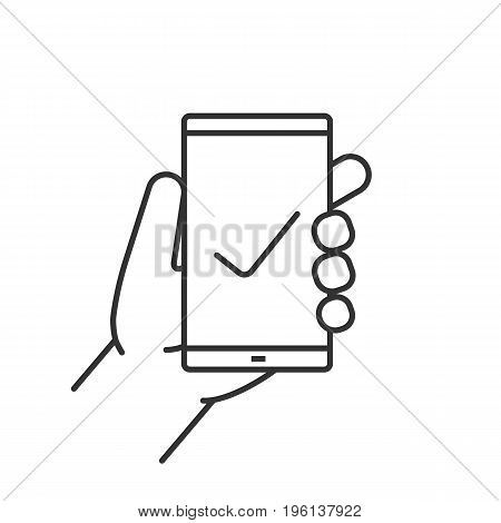 Hand holding smartphone linear icon. Thin line illustration. Smart phone with tick mark contour symbol. Vector isolated outline drawing
