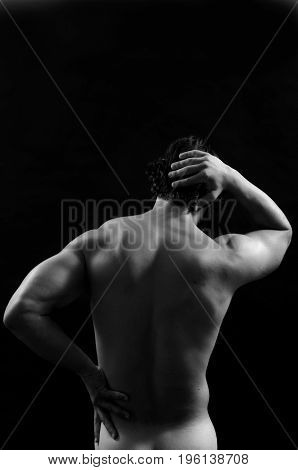 Portrait of a muscular man on black background