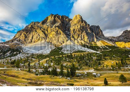 The concept of active and adventure tourism. Peaks rocks spectacularly stands on a background of clouds. Travel in the Dolomites, pass Faltsarego