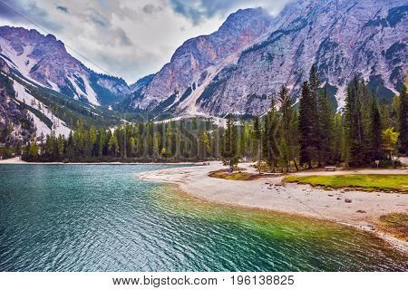 Walk around the lake Lago di Braies. Travel to South Tyrol, Italy. The concept of walking and eco-tourism