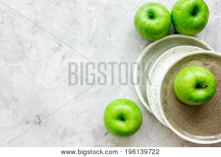 fresh organic green apples on white desk background top view mock-up