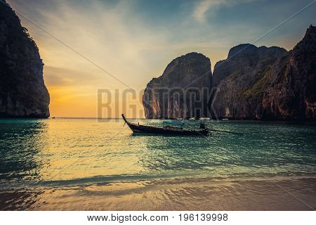 Sunset Phi phi Le island bay and longtail boat, Andaman Sea - Thailand