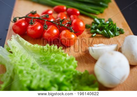 Fresh And Tasty Tomatoes, Salad, Onion, Champignon On Wooden Cutting Board