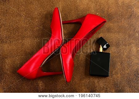 Female Shoes On Old Brown Suede Background. Fashion And Scent