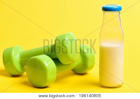 Dumbbells And Bottle Of Fresh Milk