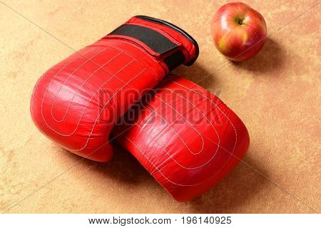 Knock Out And Healthy Nutrition Concept. Boxing Gloves In Red