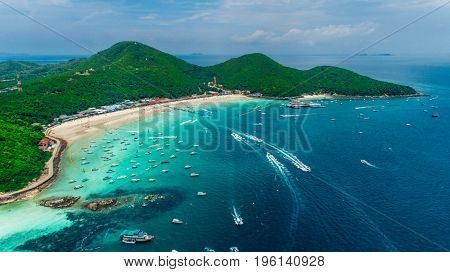 Koh Larn island and his tropical beaches. Beautiful landscape of Thailand sea and boats.Speed boats on crystal clear water. Pattaya city,Thailand.