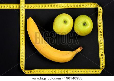 Minimalistic Art Composition With Smile Made Of Banana And Apples