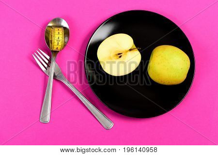 Concept Of Healthy Food With Apple Halves On Black Plate
