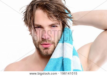 Strength and sportive shape idea. Macho with striped towel and big muscles isolated on white background. Bearded man with naked body and confident face wipes his hair. Shower time and sports concept poster