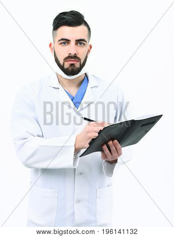 Man With Concentrated Face In White Coat And Surgical Mask